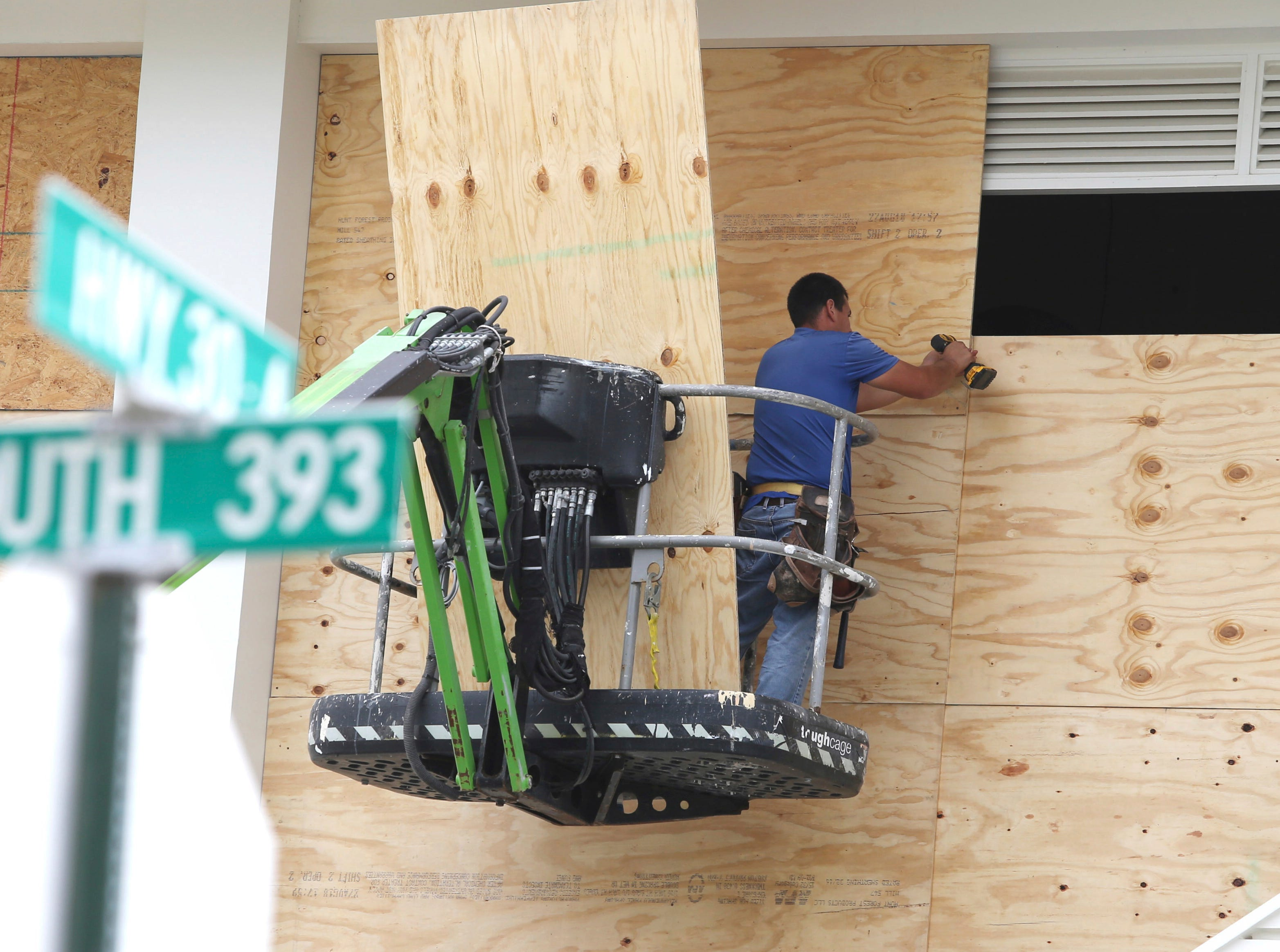 Workers finish boarding up the upper level of Shunk Gulley Oyster Bar at Gulf Place on Tues. Oct. 9, 2018 in Santa Rosa Beach, Fla., ahead of Hurricane Michael's possible landfall in the next 24 hours in South Walton County.