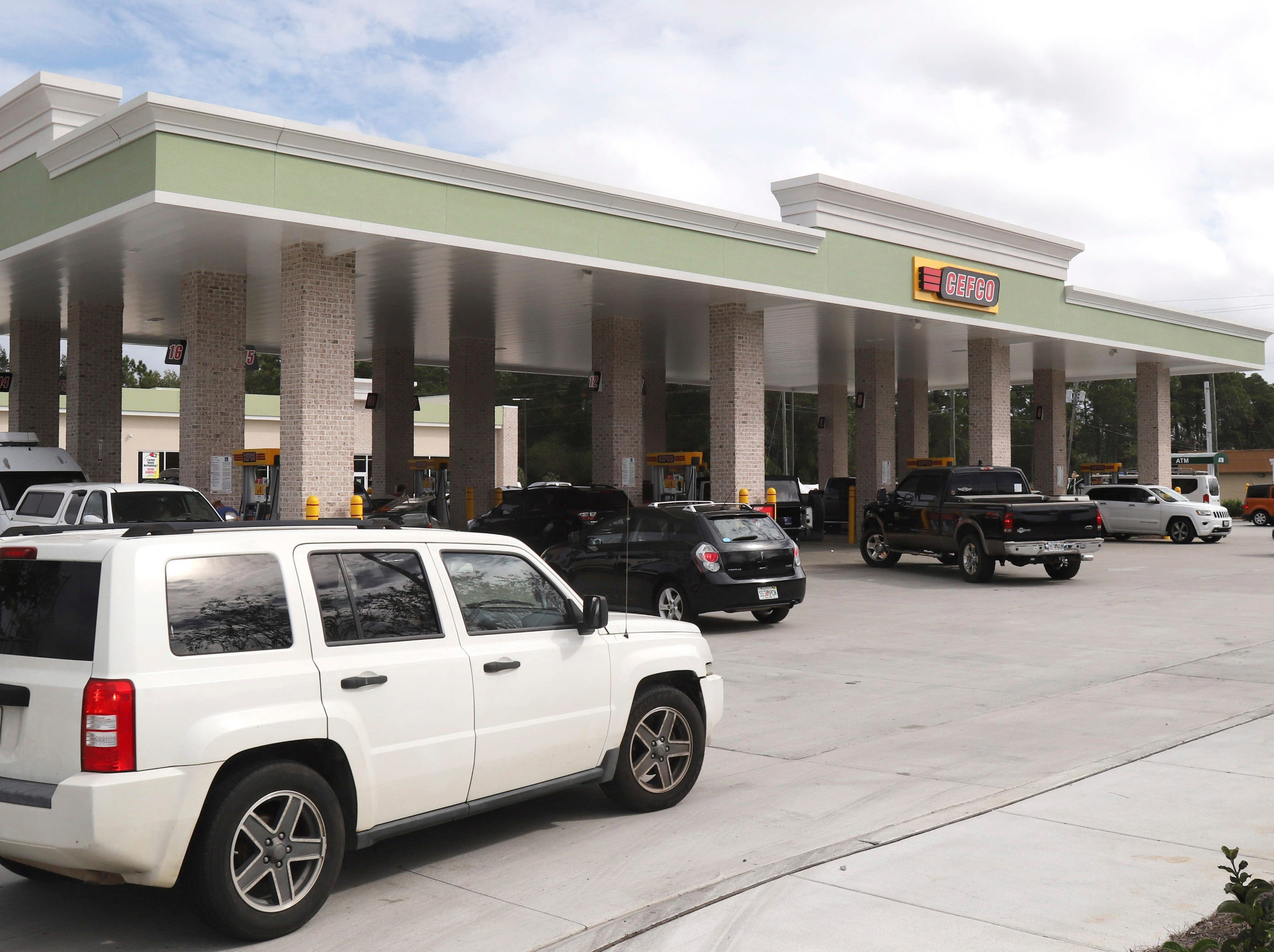 Cars jockey for position at the CEFCO gas station at County Road 393 and U.S. Highway 98 in South Walton County in Santa Rosa Beach, Fla., on Tues. Oct., 9, 2018.