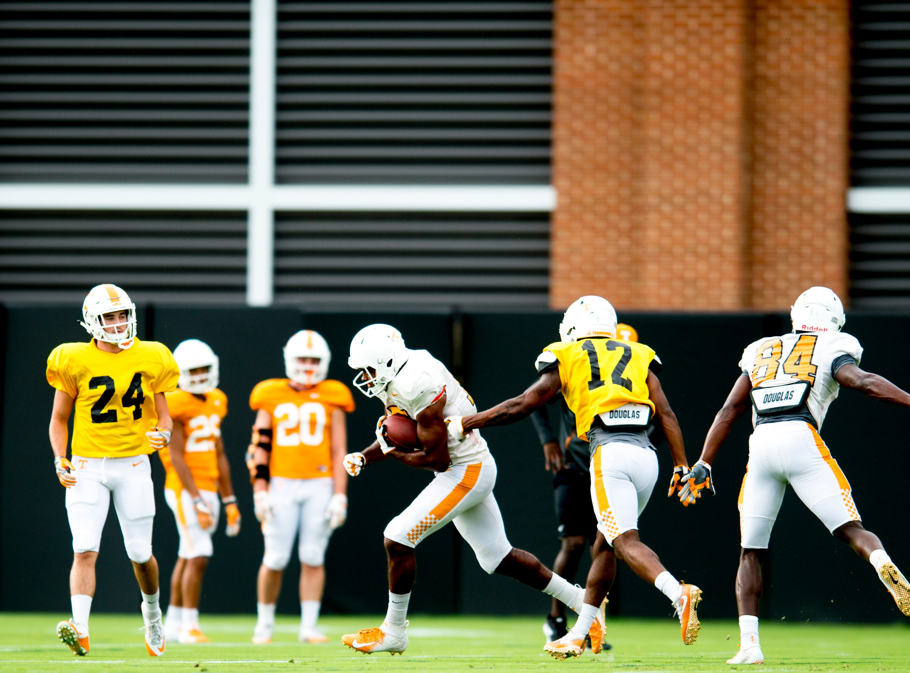 Tennessee wide receiver Jauan Jennings (15), Tennessee defensive back Shawn Shamburger (12) and Tennessee tight end James Brown (84) drill during Tennessee fall football practice at Haslam Field in Knoxville, Tennessee on Tuesday, October 9, 2018.
