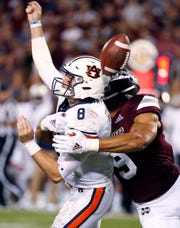 Mississippi State defensive end Montez Sweat (9) forces Auburn quarterback Jarrett Stidham to fumble as he attempts to pass during a game Oct. 6.