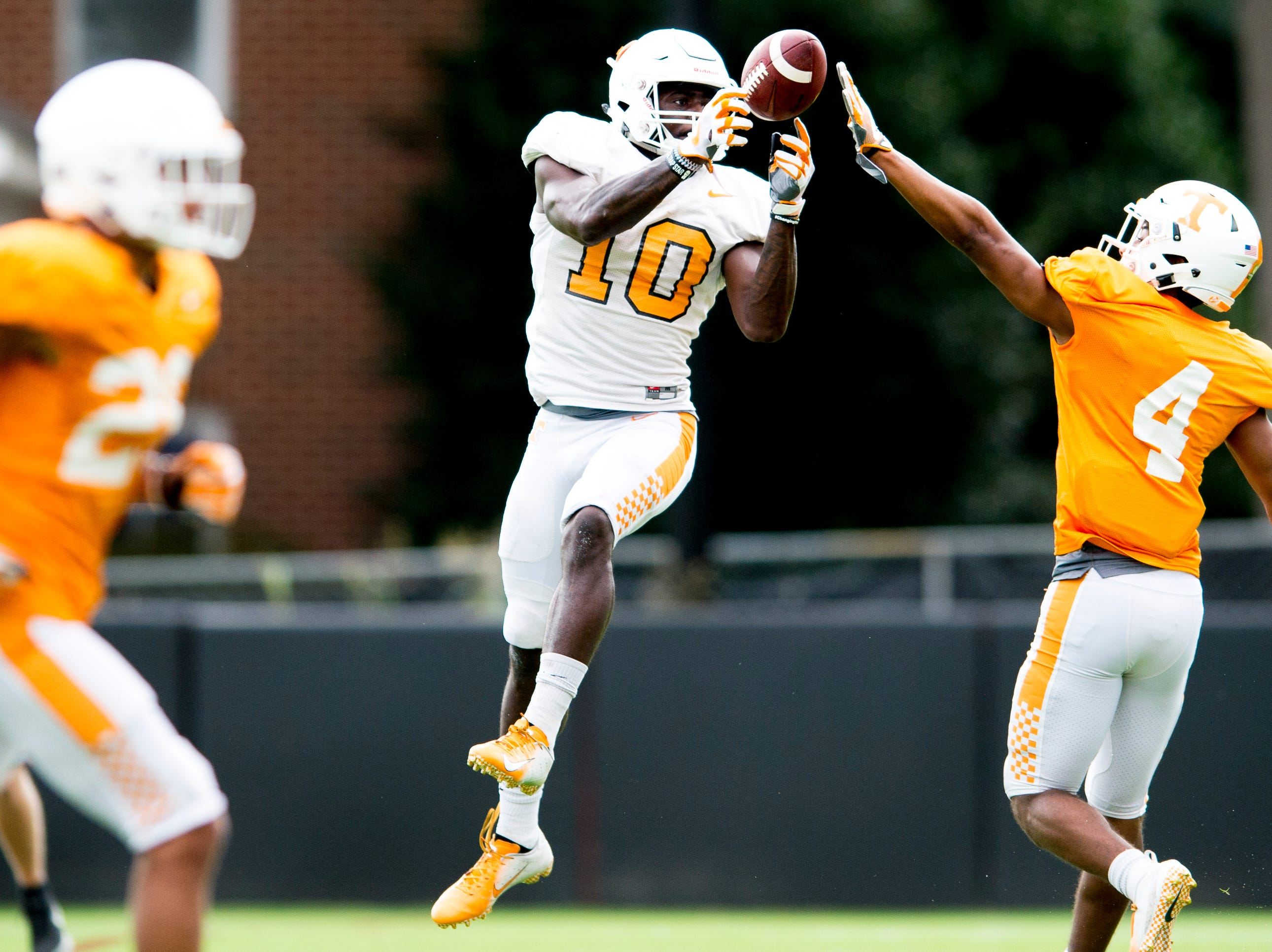Tennessee wide receiver Tyler Byrd (10) catches a pass past Tennessee defensive back Maleik Gray (4) during Tennessee fall football practice at Haslam Field in Knoxville, Tennessee on Tuesday, October 9, 2018.