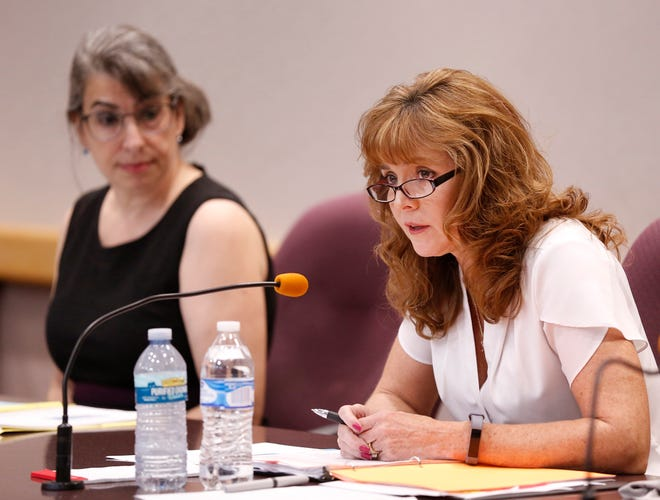 Republican Julie Roush talks about voting by mail during the Tippecanoe County Clerk debate with Democrat Vicky Woeste (background) Tuesday, October 9, 2018, in the Tippecanoe Office Building. Roush said she is leery of voting by mail.