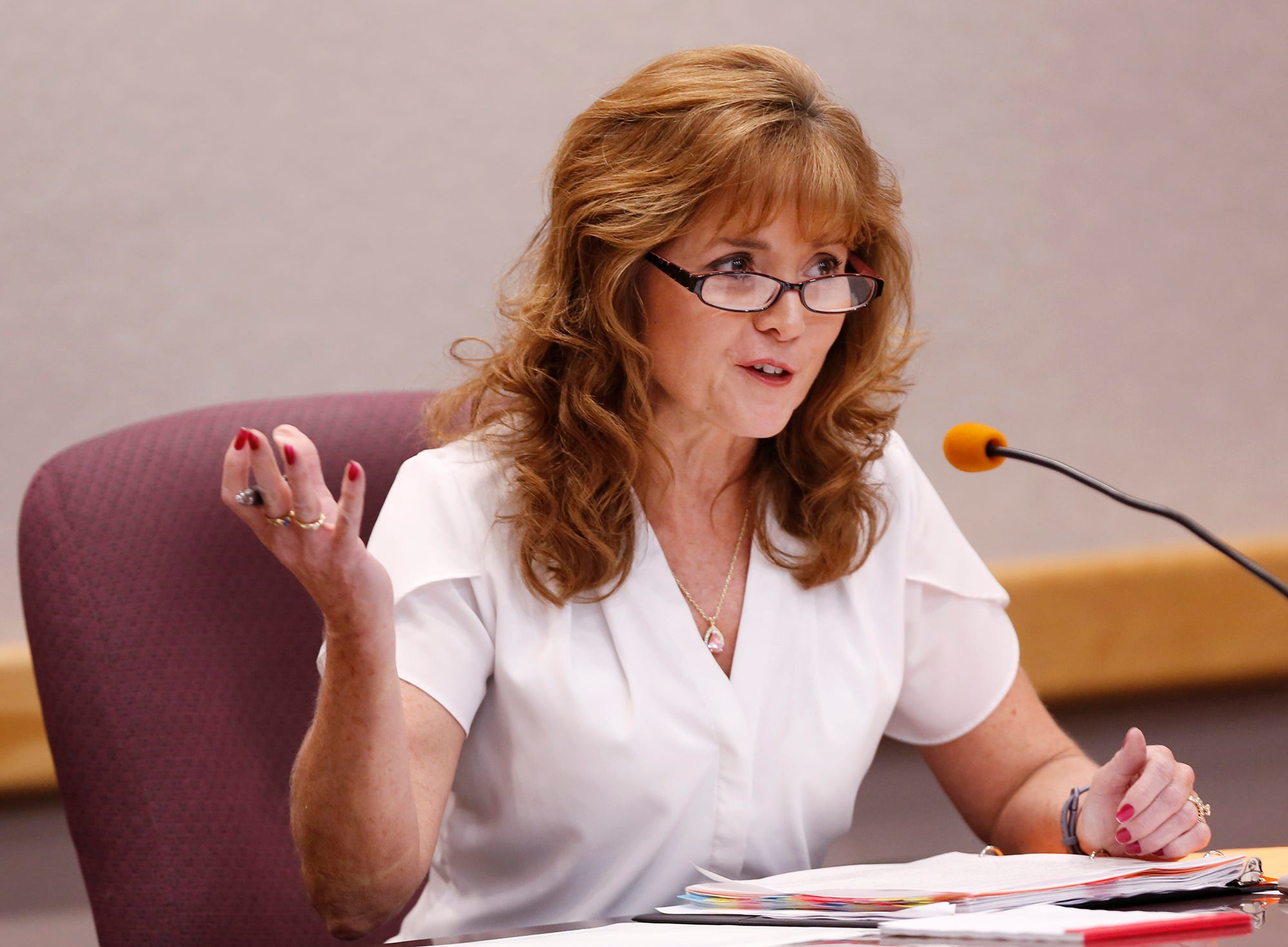 Republican Julie Roush discusses the difficulty of replacing voting machine systems during the debate for Tippecanoe County Clerk with opponent Democrat Vicky Woeste Tuesday, October 9, 2018, in the Tippecanoe Office Building.