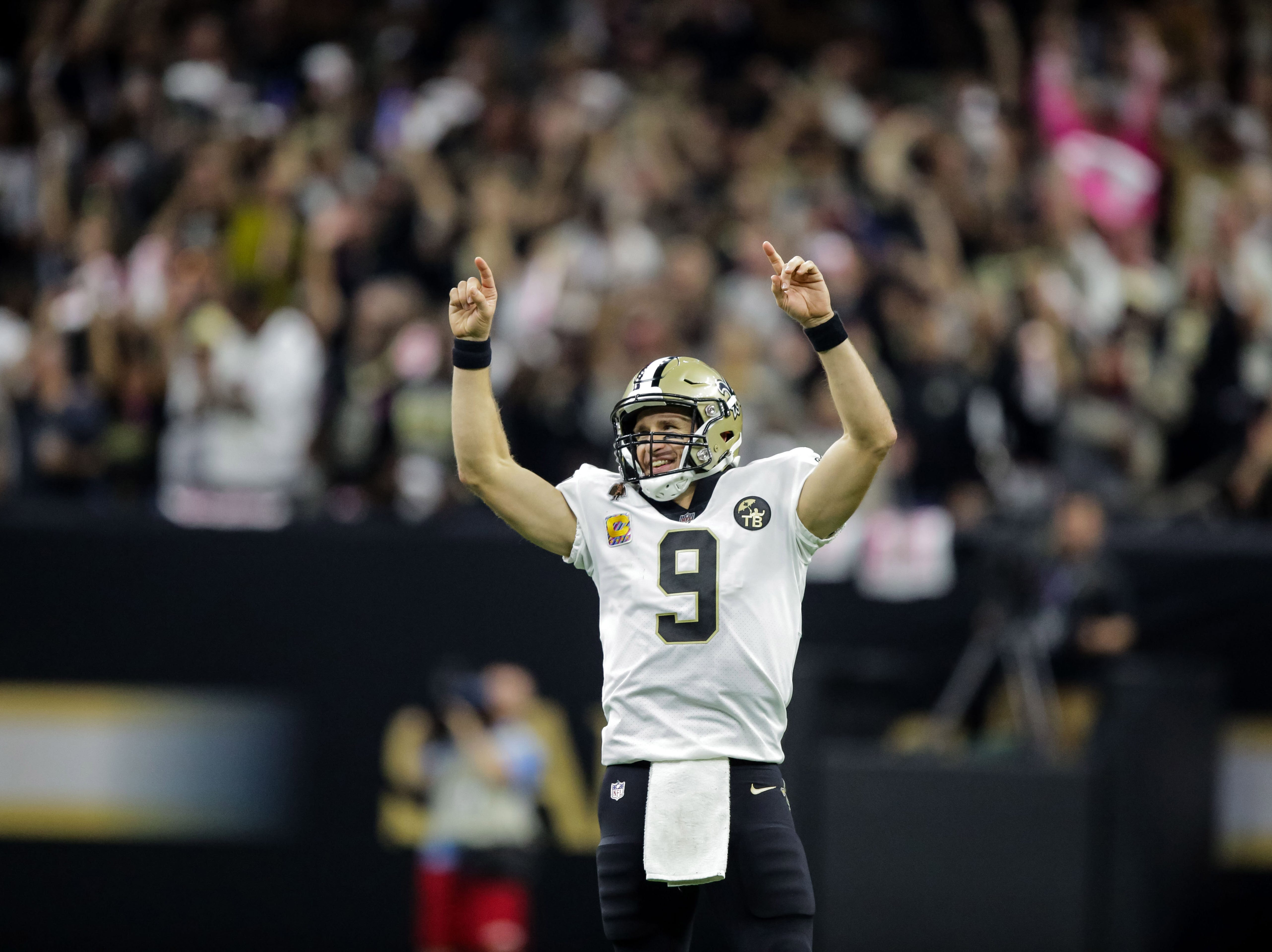 Oct 8, 2018; New Orleans, LA, USA; New Orleans Saints quarterback Drew Brees (9) reacts after setting the NFL record for passing yardage during the second quarter against the Washington Redskins at the Mercedes-Benz Superdome.