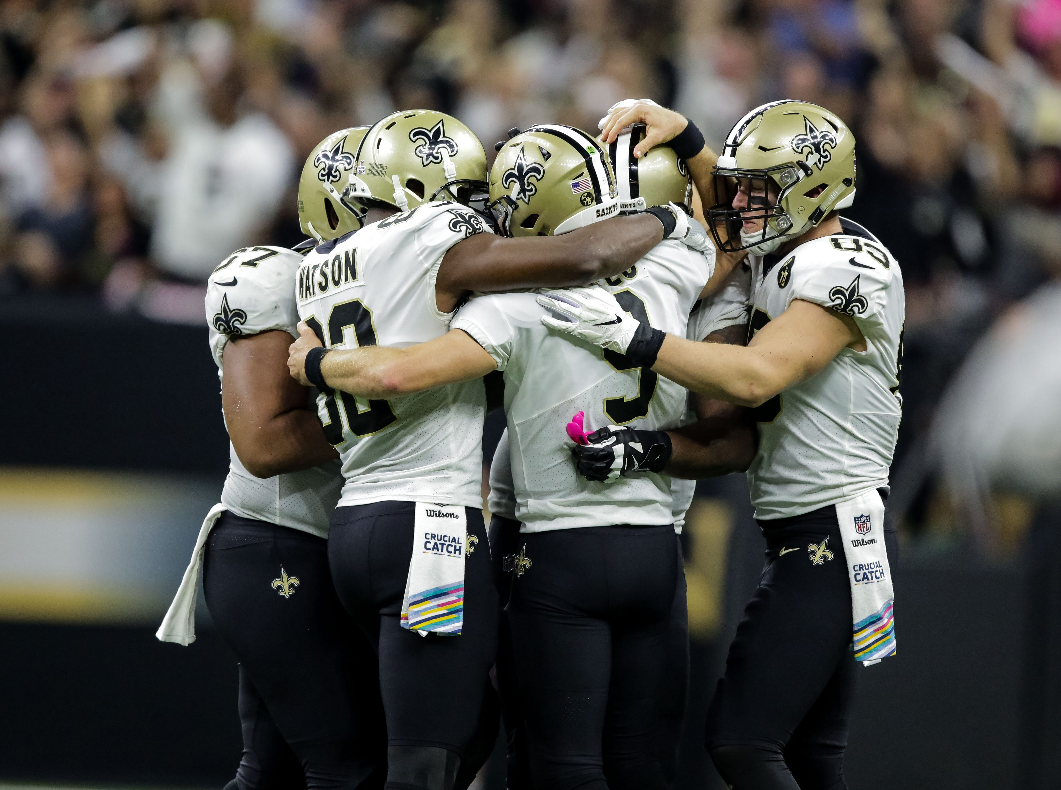 Oct 8, 2018; New Orleans, LA, USA; New Orleans Saints quarterback Drew Brees (9) celebrates with teammates after setting the NFL record for passing yardage during the second quarter against the Washington Redskins at the Mercedes-Benz Superdome.