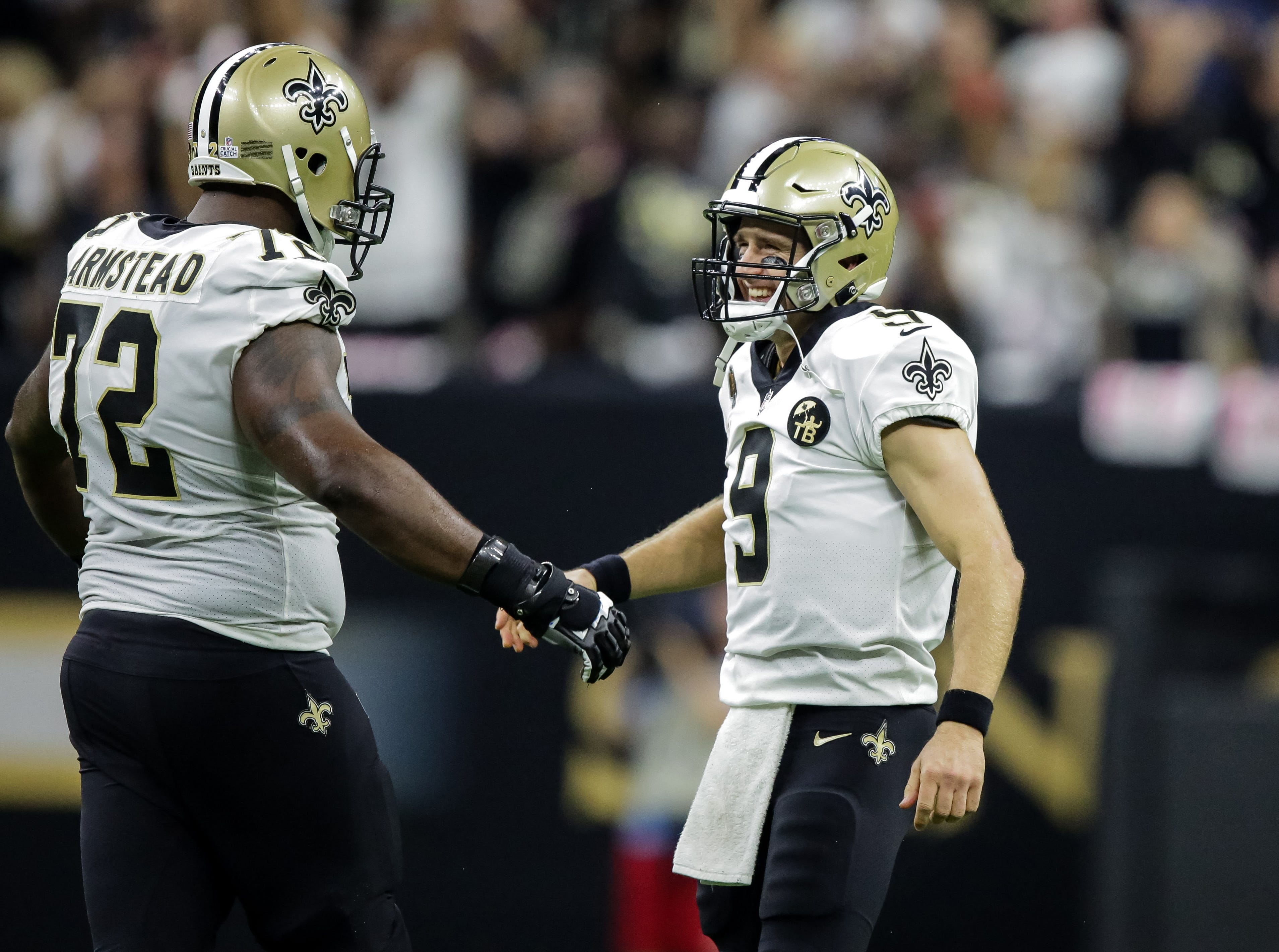 Oct 8, 2018; New Orleans, LA, USA; New Orleans Saints quarterback Drew Brees (9) celebrates with offensive tackle Terron Armstead (72) after setting the NFL record for passing yardage during the second quarter against the Washington Redskins at the Mercedes-Benz Superdome.