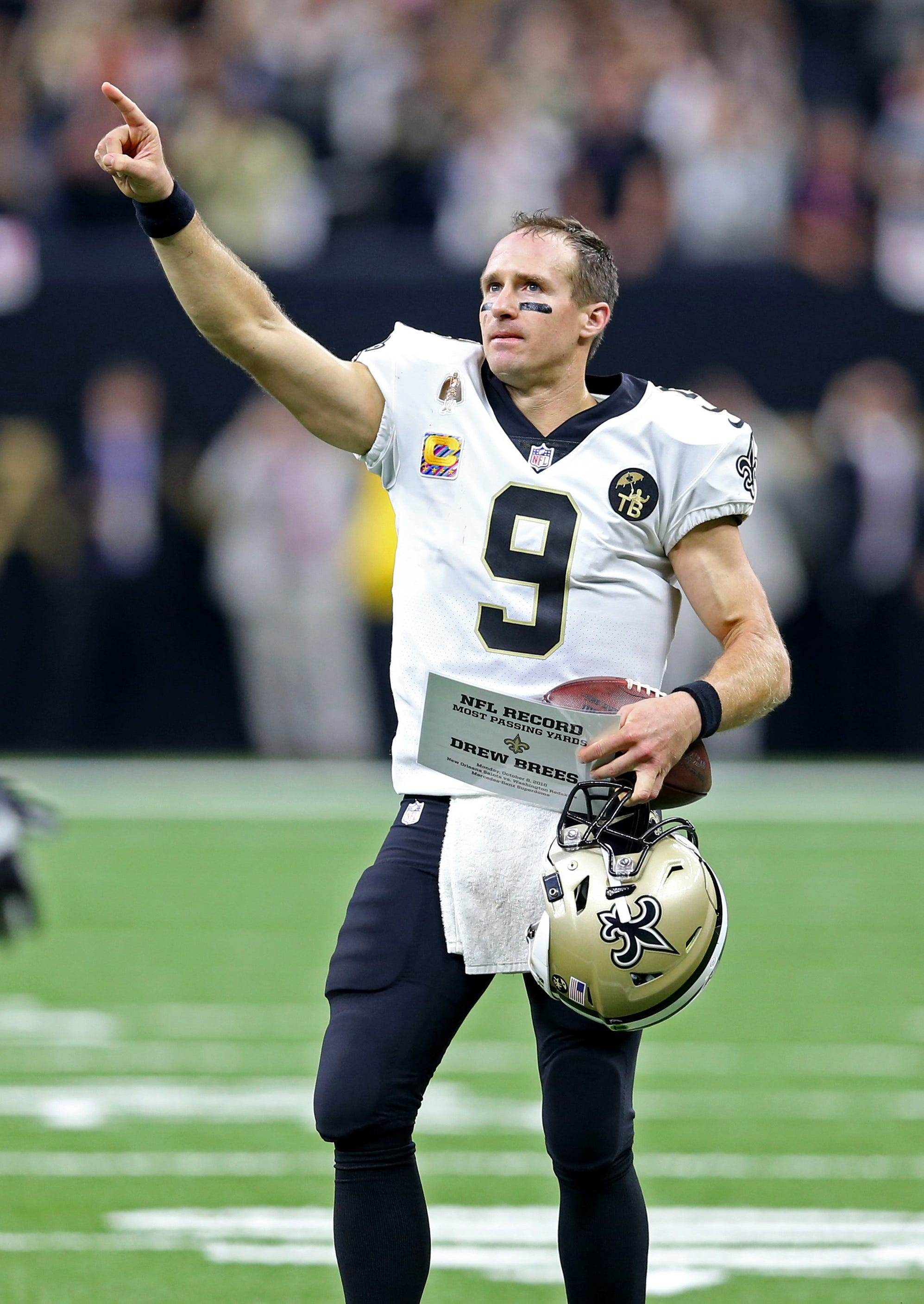 Oct 8, 2018; New Orleans, LA, USA; New Orleans Saints quarterback Drew Brees (9) acknowledges the crowd after setting the all-time NFL passing yardage mark against the Washington Redskins in the second quarter at the Mercedes-Benz Superdome. Mandatory Credit: Chuck Cook-USA TODAY Sports
