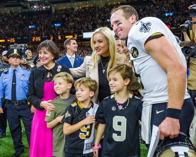 New Orleans Saints quarterback Drew Brees celebrates after becoming the quarterback with the most passing yards in the history of the NFL, against Washington Redskins during Monday Night Football at the Mercedes-Benz Superdome. Monday, Oct. 8, 2018.