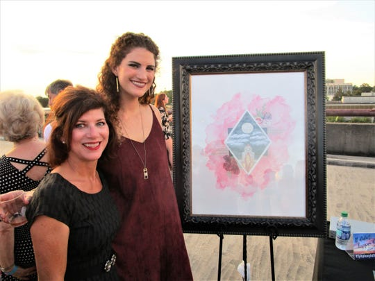 Renee Reaux with daughter Gracie Reaux, artist of the official poster for the event