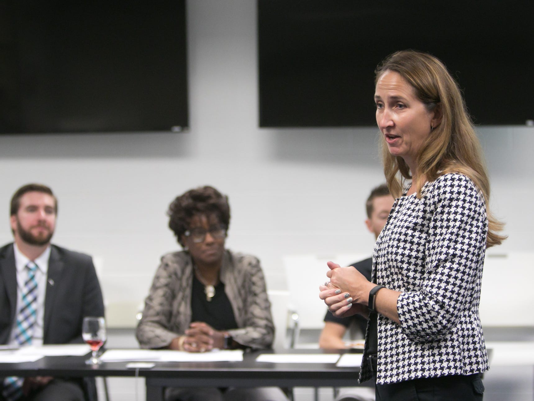 Michelle Radcliffe, executive director at LATEC, speaks at the tour for IBM executives at the Pinckney Cyber Training Institute Tuesday, Oct. 9, 2018.