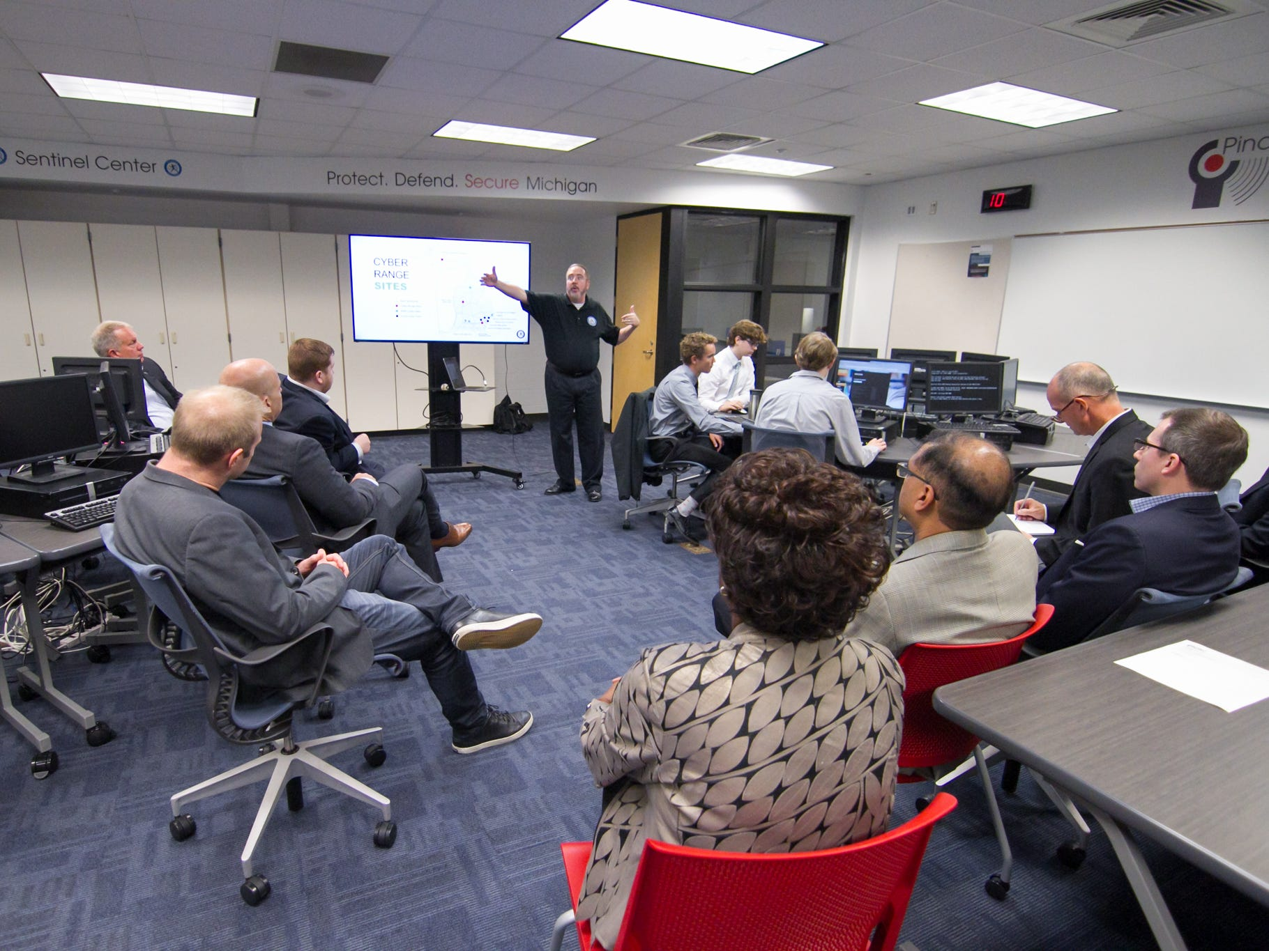 Joe Adams outlines the use of the Cyber Range capabilities for learning at a tour of the Pinckney Cyber Training Institute by IBM executives Tuesday, Oct. 9, 2018.