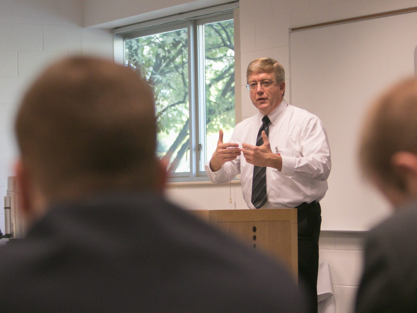 Jim Darga, director of Pinckney Cyber Training Institute, talks about the program to IBM executives touring the facility Tuesday, Oct. 9, 2018.