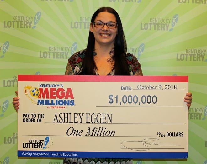 Ashley Eggen, of Elizabethtown, with her $1 million Mega Millions lottery prize on Oct. 9, 2018.