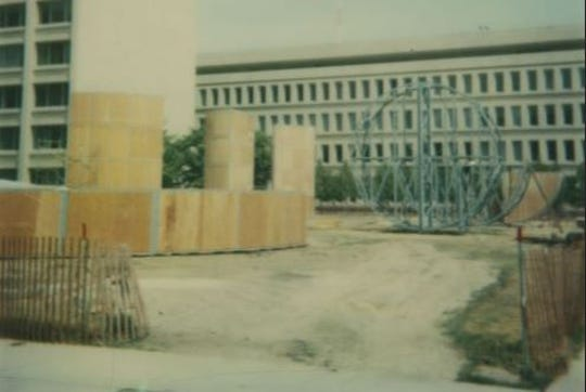 """Michael Heizer's sculpture """"This Equals That' was built in 1979. A dedication ceremony held the following year in downtown Lansing drew some protesters."""