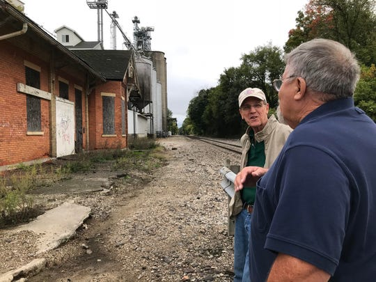 Charlotte area resident Dave Bankhead (right)_ and Eaton County Courthouse Square Association President Rod Weaver talk about the future of Grand Trunk Station, just off North Cochran Avenue. The station is more than a century old and crumbling. Now they are interested in saving and restoring it.