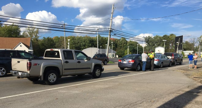 A four-vehicle crash snarls traffic on US 42 at McElroy Road, just northeast of the US 30 interchange, on Tuesday.