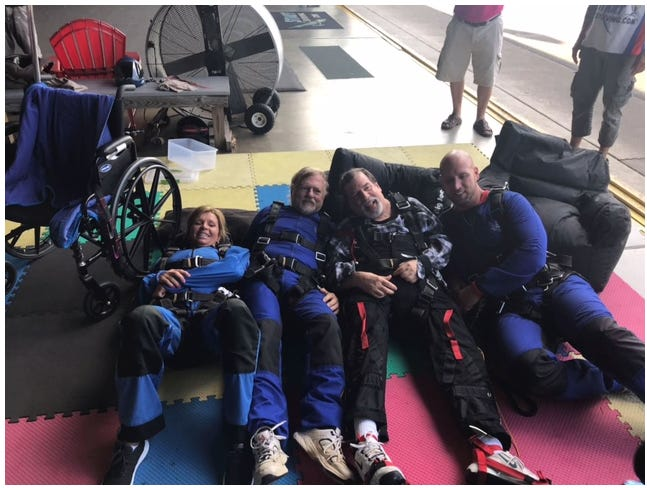 Chuck Tucker, a resident at Crystal Care Center in Mansfield, went skydiving Monday. From left are Crystal Care Center nurse Candy Turner, Jerry Smith, the owner of Crystal Care Center; Chuck Tucker; and Rick Tucker, Chuck's son.