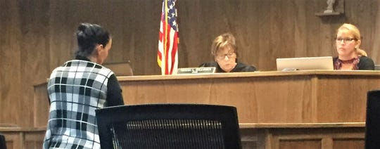 Petra Smith, 53, stands in front of judge Teresa Ballinger during her arraignment on Tuesday. The Marion resident pleaded guilty to misdemeanor assault after being accused of grabbing a 13-year-old boy's head and pushing it back during an argument Sunday morning.