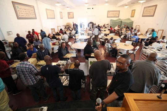 Dozens of people line up for a hot meal at the Memphis Union Mission Tuesday, Oct. 9, 2018. The Mission is set to begin a $60 million expansion this month, expanding their kitchen, adding more beds and eventually creating a space for third party medical care providers to service patients.