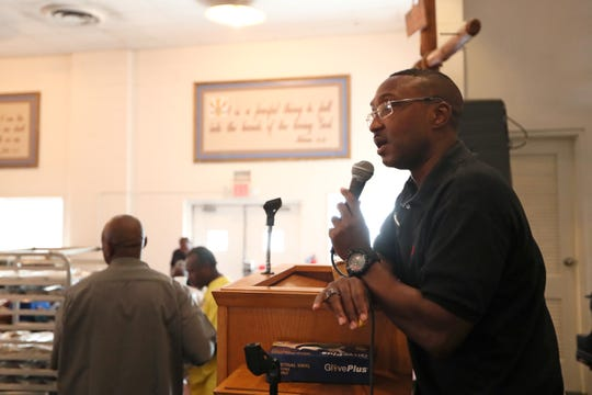 """Ed Rucker, building supervisor at the Memphis Union Mission, speaks to the clients receiving lunch after addressing them with a pre-meal prayer on Tuesday, Oct. 9, 2018. The Mission, which will break ground on a new expansion to their facilities will nearly double their available beds, among other resources. """"Expansion is 300 more beds,"""" said Rucker. """"It means they are able to be off the street, get clean clothes and a sense of peace. This is a safe space."""""""