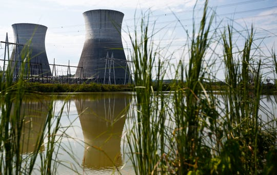 In this Wednesday, Sept. 7, 2016 file photo, two cooling towers can be seen in the reflection of a pond outside of the Bellefonte Nuclear Plant, in Hollywood, Ala.