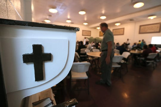Dozens of people eat a hot meal at the Memphis Union Mission Tuesday, Oct. 9, 2018. The Mission is set to begin a $60 million expansion this month, expanding their kitchen, adding more beds and eventually creating a space for third party medical care providers to service patients.