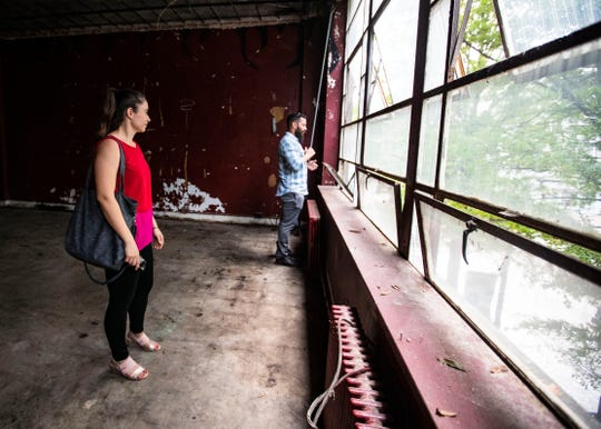Gabriel Velasquez and Patricia Urcuyo look out the windows on the second floor of 64 South Main Street on Tuesday October 9, 2018.  Construction has begun on the first floor of the 11,000-square-foot building.