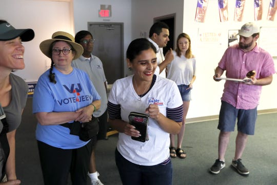 Gabby Salinas, Democratic candidate for the District 31 State Senate seat, shares a laugh with volunteers who joined her to canvass neighborhoods in Germantown on Saturday, Oct. 9, 2018.
