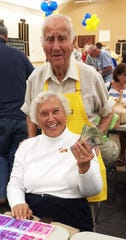 Ellie Leeydecker, with Bingo committee member Herb Kern, won at Monday Night Bingo.
