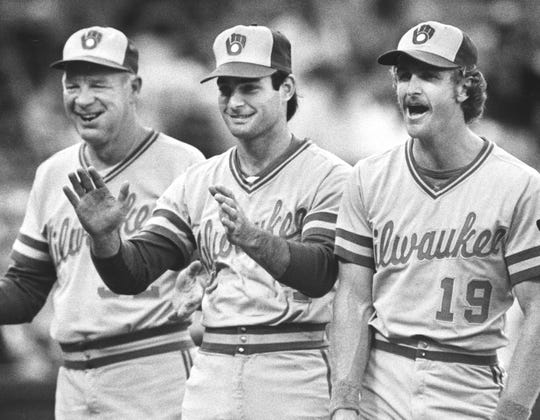1982 BREWERS: L TO R. HARVEY KUENN, PAUL MOLITOR, AND ROBIN YOUNT - Pre-game introductions - 1982 American League playoff.  Also published  7-18-99, Robin Yount 5S; The affable Harvey Kuenn led Paul Molitor, Robin Yount and their teammates to the World Series in 1982.   Also published Milwaukee Sentinel; 2-29-1988;  Harvey Kuenn (lower right) was all smiles as the Brewers were introduced prior to the start of the 1982 American League Championship Series. Paul Molitor and Robin Yount were next to the Brewer skipper.
