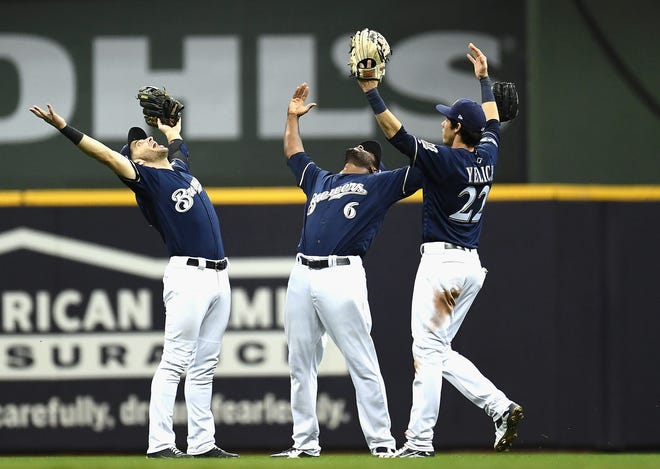 MILWAUKEE, WI - OCTOBER 05:  (L-R)  Ryan Braun #8, Lorenzo Cain #6, and Christian Yelich #22 of the Milwaukee Brewers celebrate their 4-0 win in Game Two of the National League Division Series over the Colorado Rockies at Miller Park on October 5, 2018 in Milwaukee, Wisconsin.  (Photo by Stacy Revere/Getty Images)