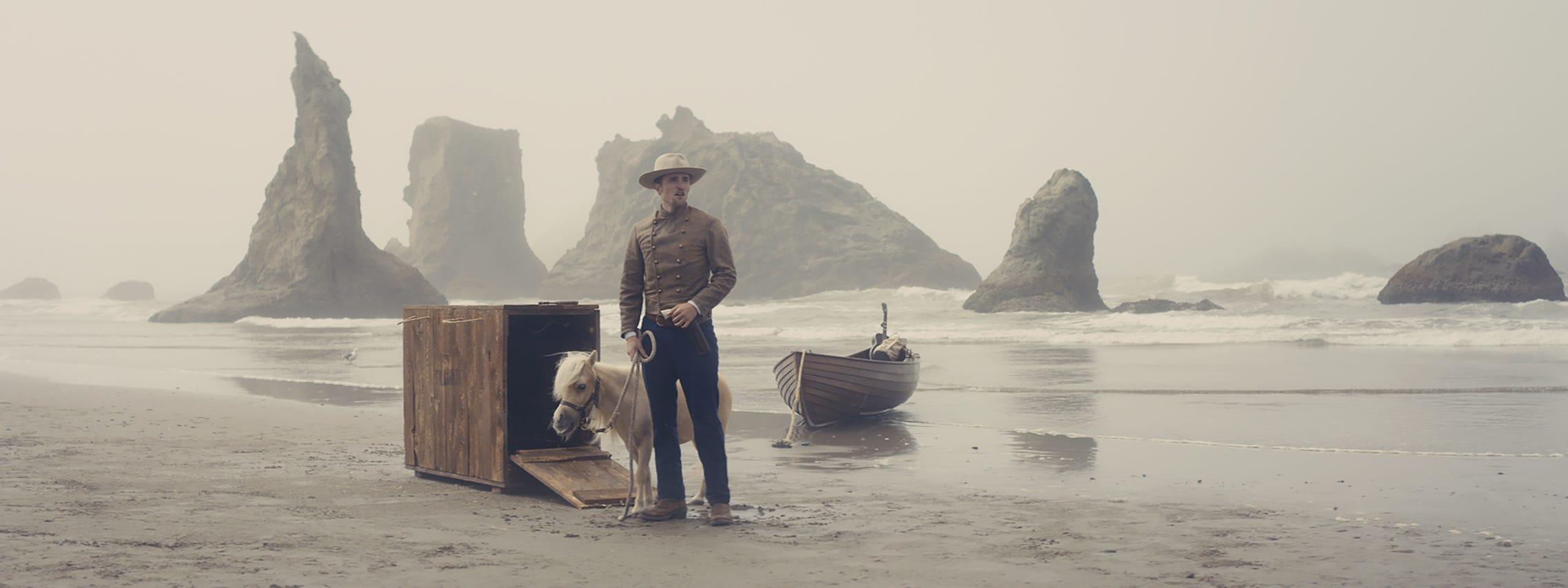 "Robert Pattinson (and his miniature horse) star in the oddball Western ""Damsel."""