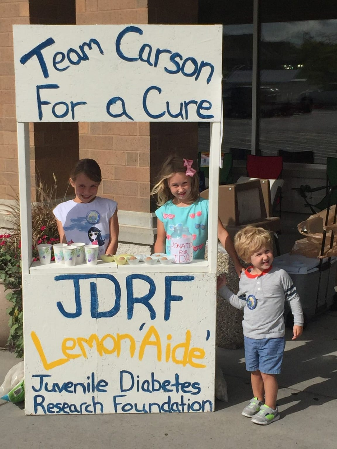 Kayla and Kendall Ford sell lemonade to raise money for Type 1 diabetes research, in honor of their little brother, Carson.