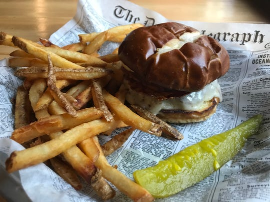 "Skippy's offers a special burger of the month. This month's is the ""Old 57,"" named for Green Bay Road, which Skippy's is on. The burger comes with bacon, harvati cheese and house-made pub sauce."