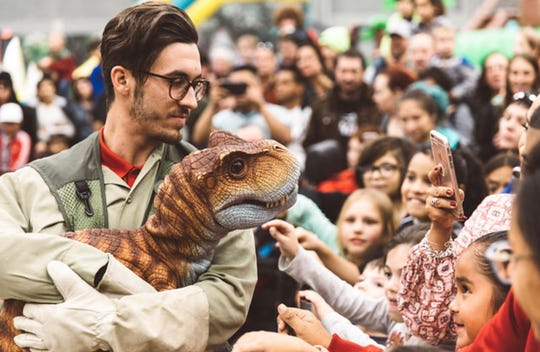 Jurassic Quest visitors can meet baby Triceratopses, Camarasauruses and Tyrannosaurus Rexes, which are life-like puppets.