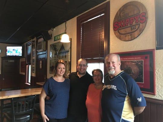 (From left) Katie, Brett, Janis and Ken Kucharski rebranded their establishment from Skippy's Sports Bar to Skippy's Burger Bar in February of this year.