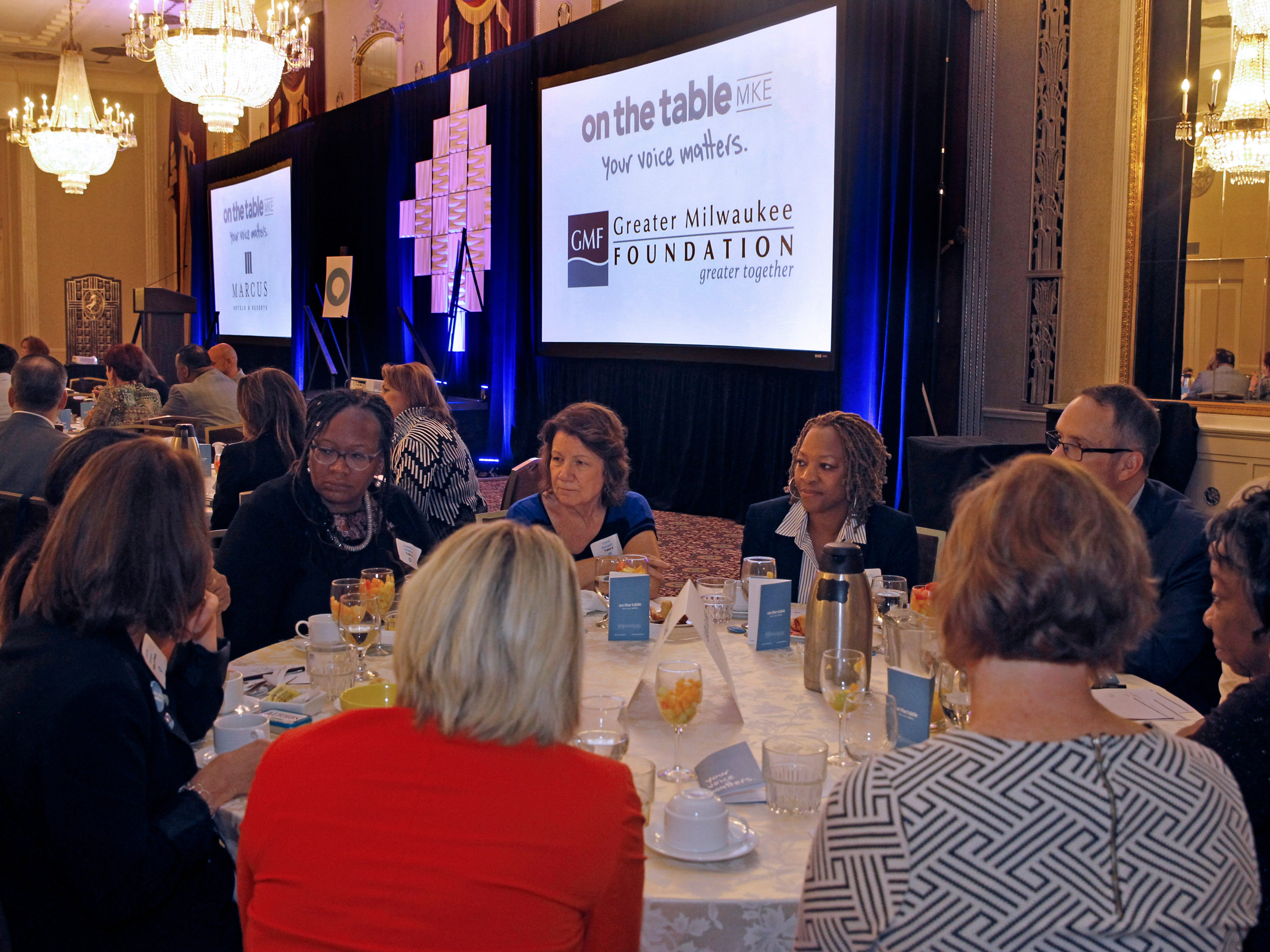A crowd of about 200 gather Tuesday for On the Table, a regional event sponsored by the Greater Milwaukee Foundation at Hilton City Center, 509 W. Wisconsin Ave.