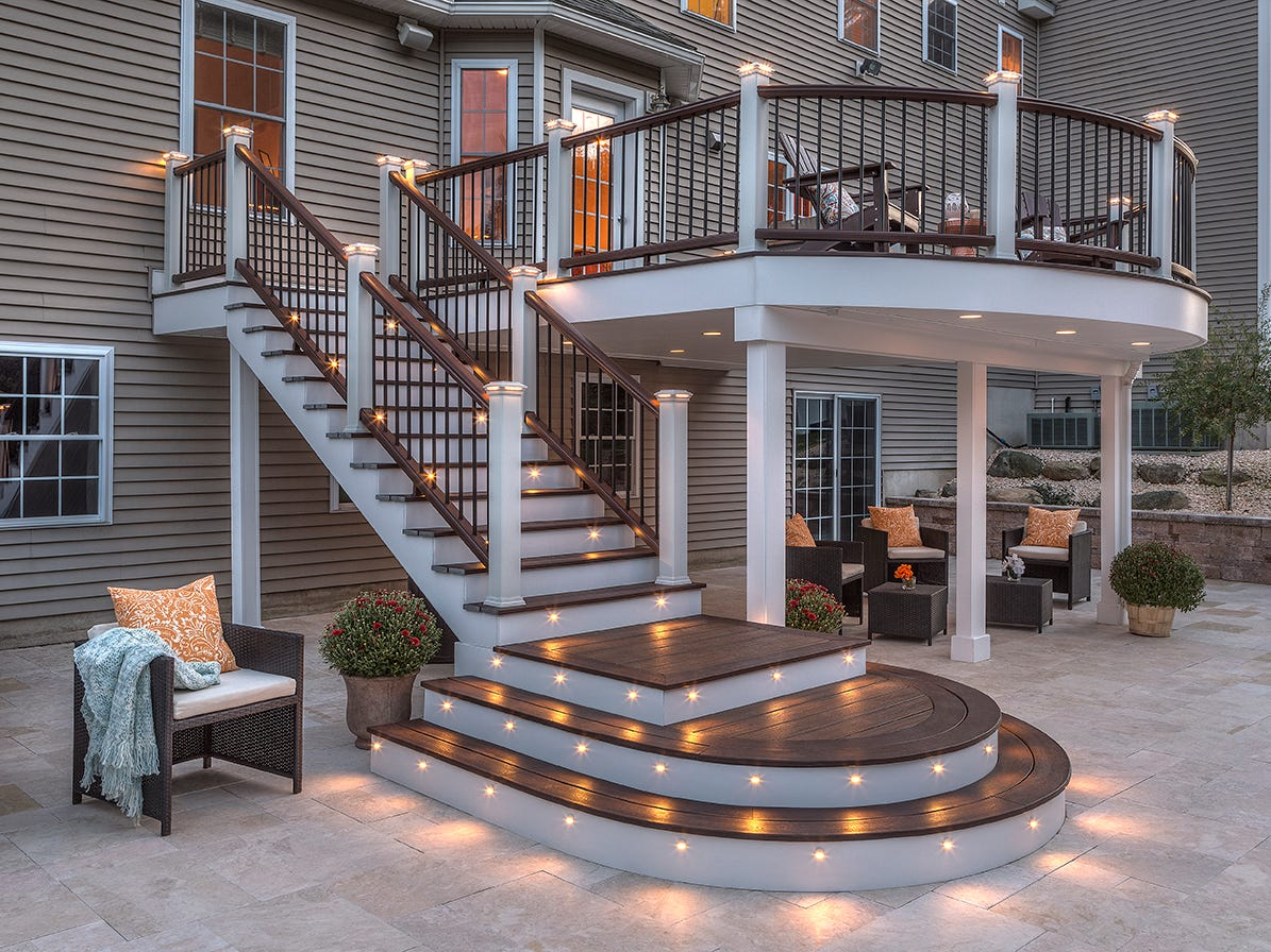 This large deck is enhanced by outdoor lighting that shines up, down and horizontally, giving the space a warm and cozy look.