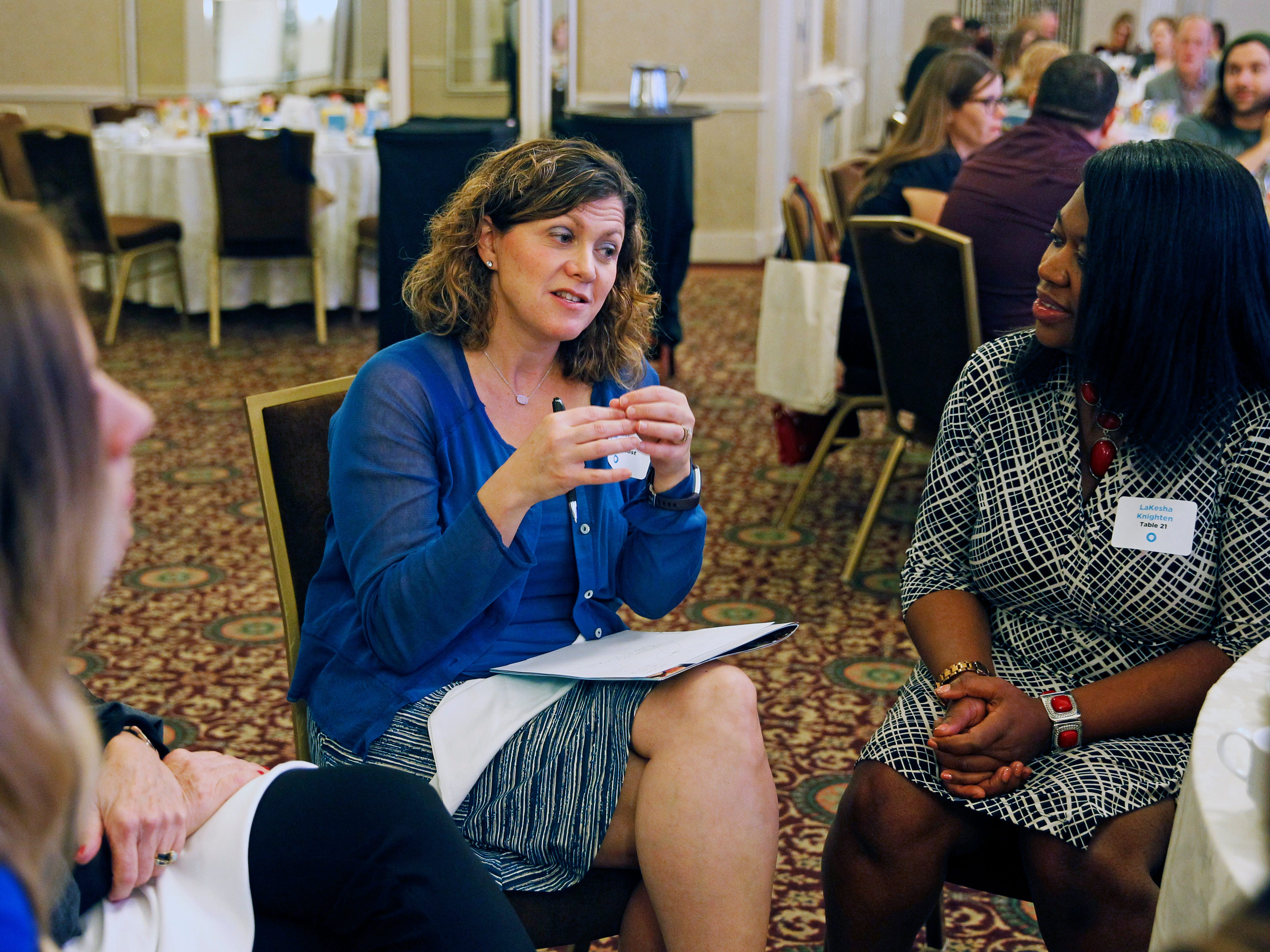 """Ellen Friebert Schupper (center) a  discussion on the topic of """"The power of one to one to create community change"""" at On the Table, a regional event sponsored by the Greater Milwaukee Foundation on Tuesday.  LaKesha Knighten (right) listens during the event at  the Hilton City Center, 509 W. Wisconsin Ave., that was aimed at getting people to brainstorm about issues confronting their communities and ways to resolve problems."""