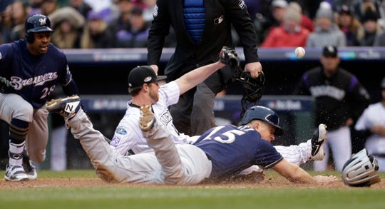 Erik Kratz home safely on a wild pitch in the sixth inning of Game 3 of the NLDS.