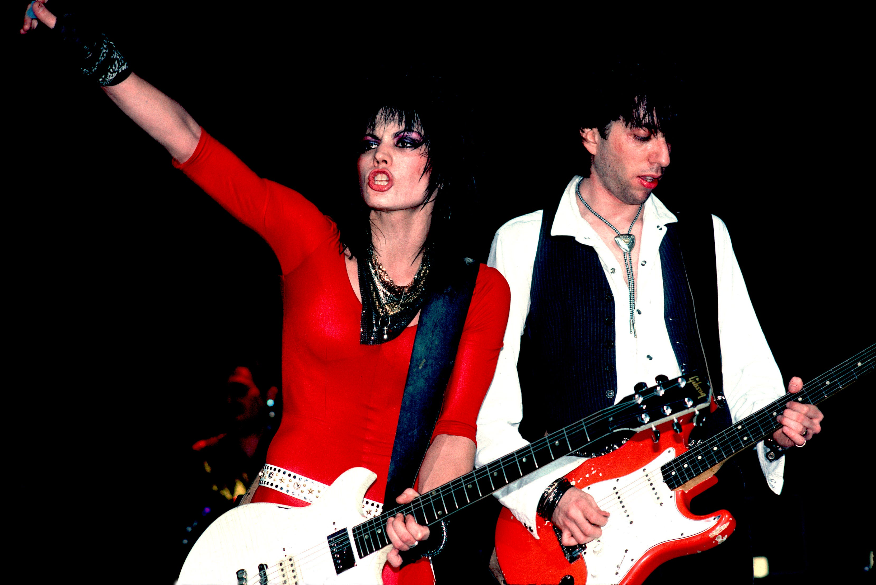 """Rock legend Joan Jett (left, with Kasim Sutton) takes the stage at Chicago's Holiday Star Theater in 1985. Jett is the focus of the documentary """"Bad Reputation."""""""