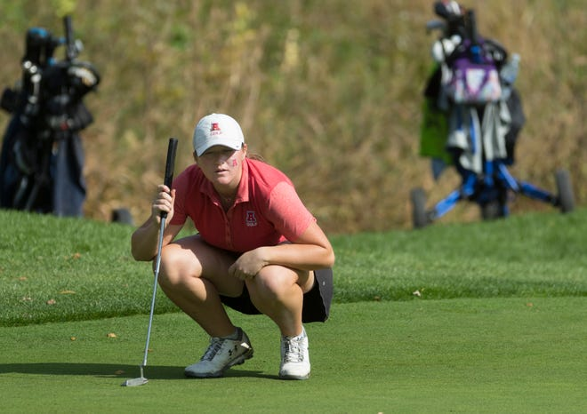 Arrowhead's Emily Lauterbach lines up her putt on the 14th green during the final round of the WIAA state girls golf tournament.