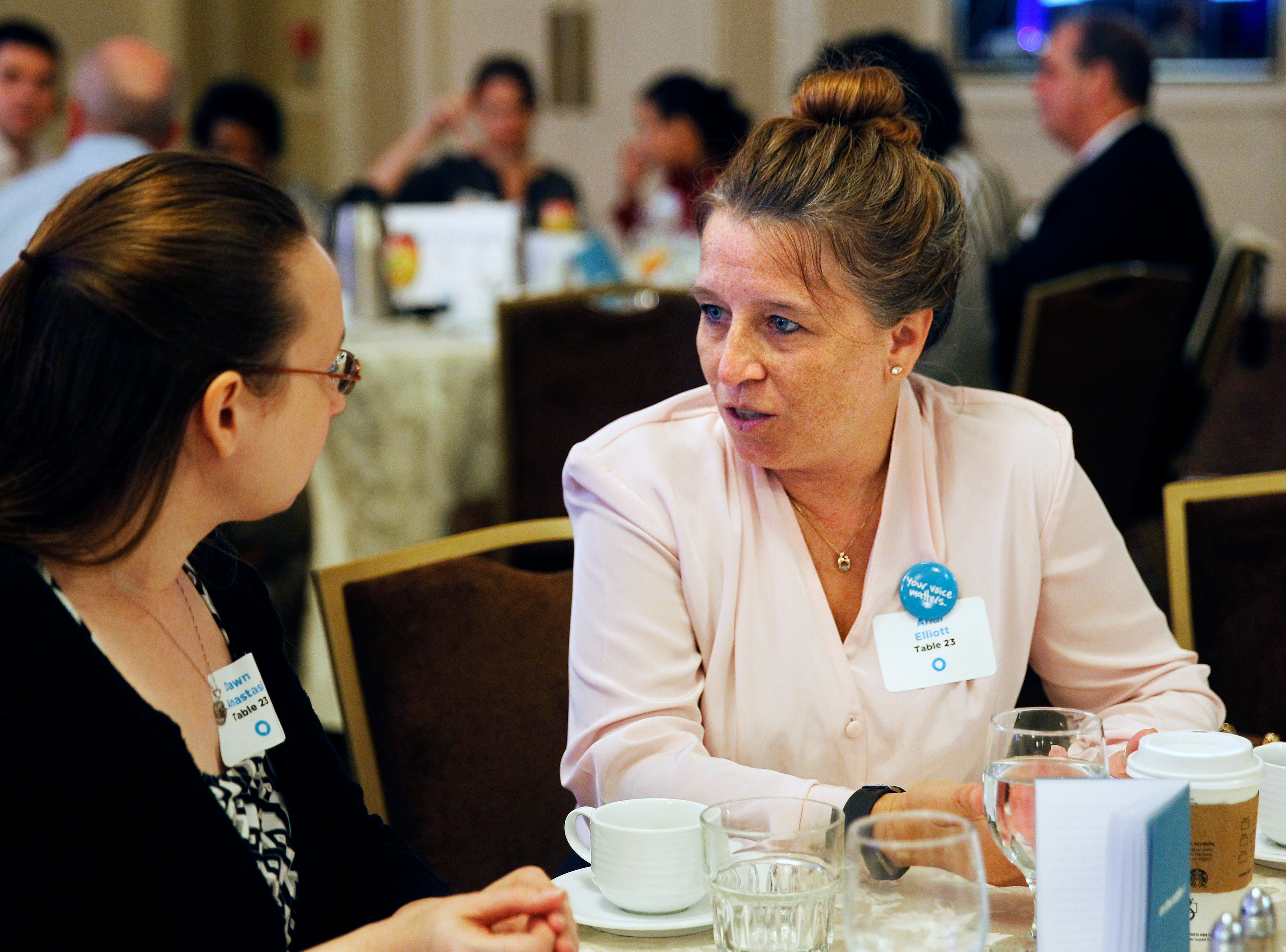 Andi Elliott (right), chief executive officer at Community Advocates Inc., talks with Dawn Anastasi from the Apartment Association of South Eastern Wisconsin at On the Table.