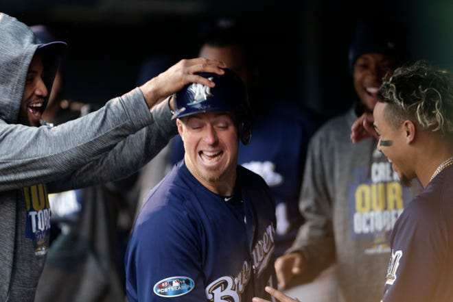 Erik Kratz celebrates with teammates after scoring on wild pitch in Game 3 of the NLDS vs. Colorado.