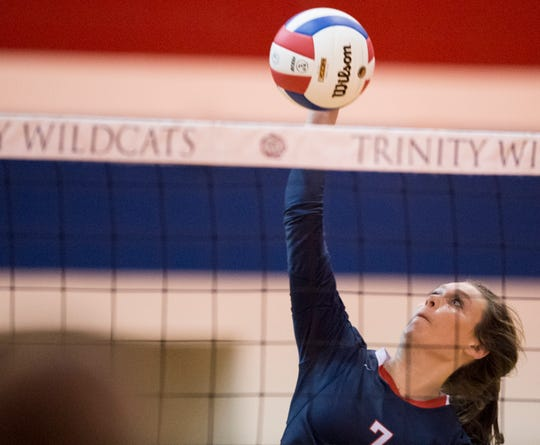 Trinity's Lucy Williams (7) attempts a kill against LAMP at Trinity Presbyterian School in Montgomery, Ala., on Tuesday, Oct. 9, 2018. Trinity defeated LAMP in three sets.