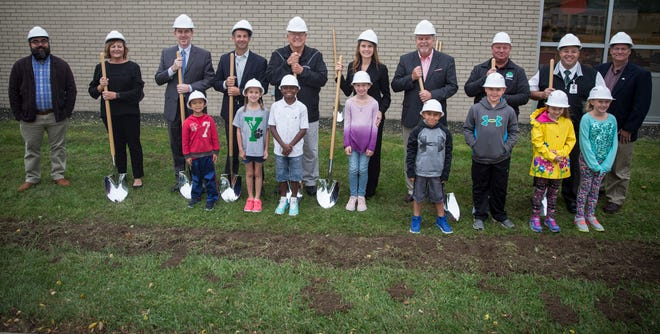 Students and administrators bring out ceremonial shovels for the official ground breaking of a multi-million dollar expansion project at Pleasant View Elementary. The project will add up to six classrooms, a new front office space and cafeteria.