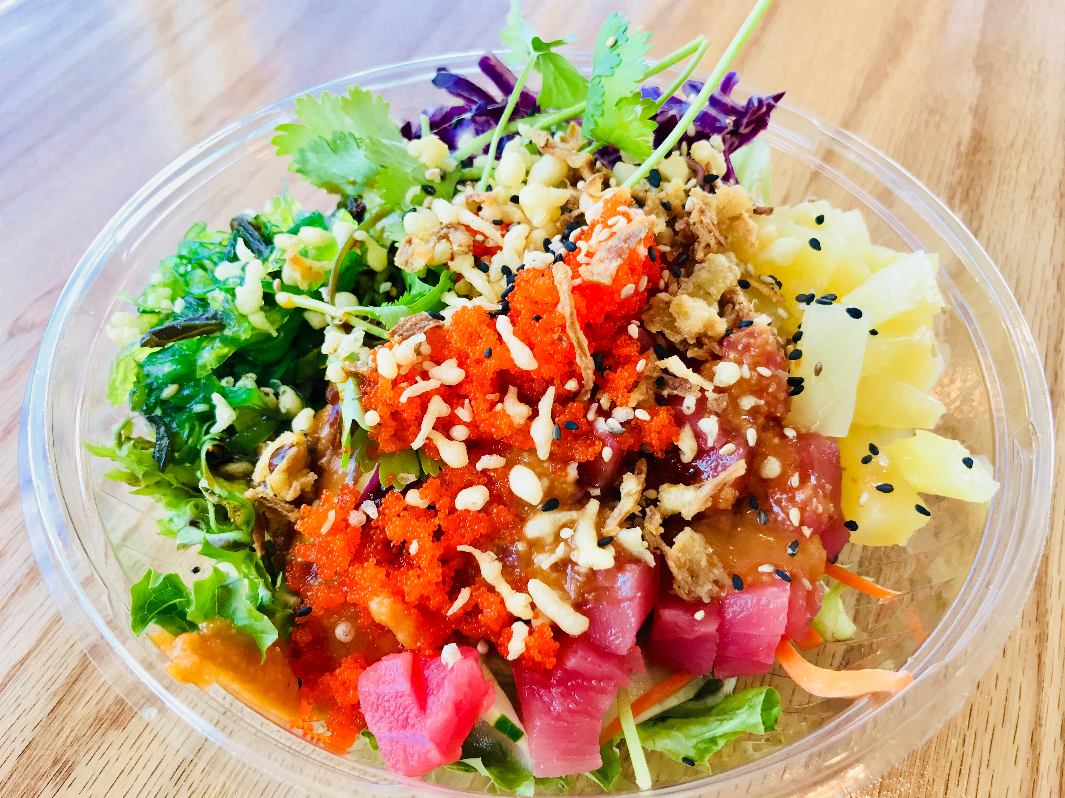 Poke Fun: This build-your-own poke bowl features ahi tuna on a bed of greens and topped with onions, red cabbage, cilantro, cucumber, scallions and carrots, along with ginger and poke sauces, seaweed salad, pineapple, crispy onions, roasted sesame seeds and tempura flakes.