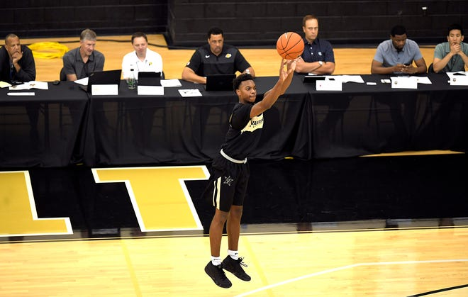 Scouts from NBA teams attend a Pro Day at Vanderbilt on Tuesday, Oct. 9, 2018. Vandy's Darius Garland shoots a 3-pointer  as scouts from NBA teams watch.