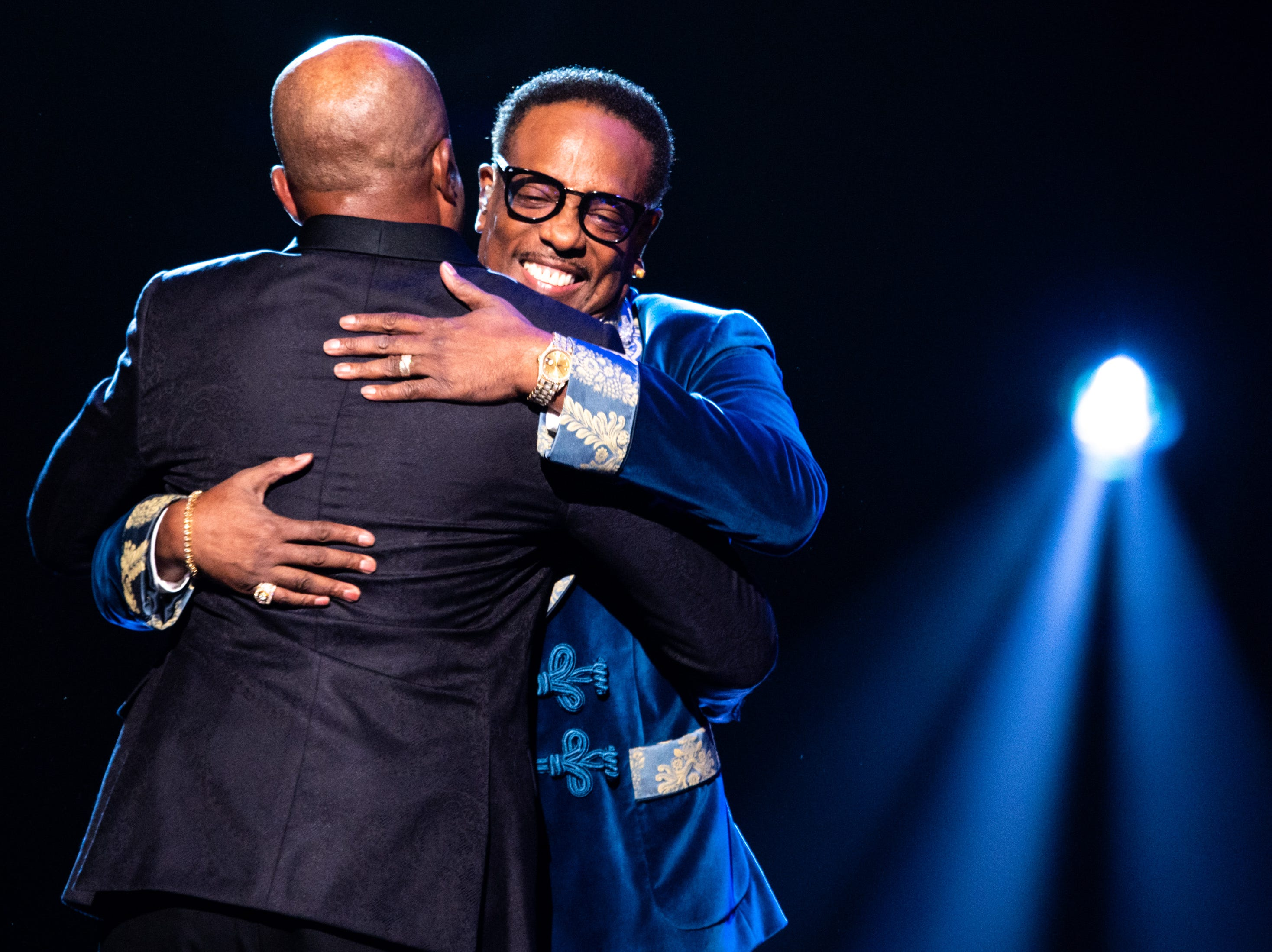 Darius Rucker, left, hugs Charlie Wilson, right, performs during the An Opry Salute to Ray Charles concert at The Grand Ole Opry in Nashville, Tenn., Monday, Oct. 8, 2018.