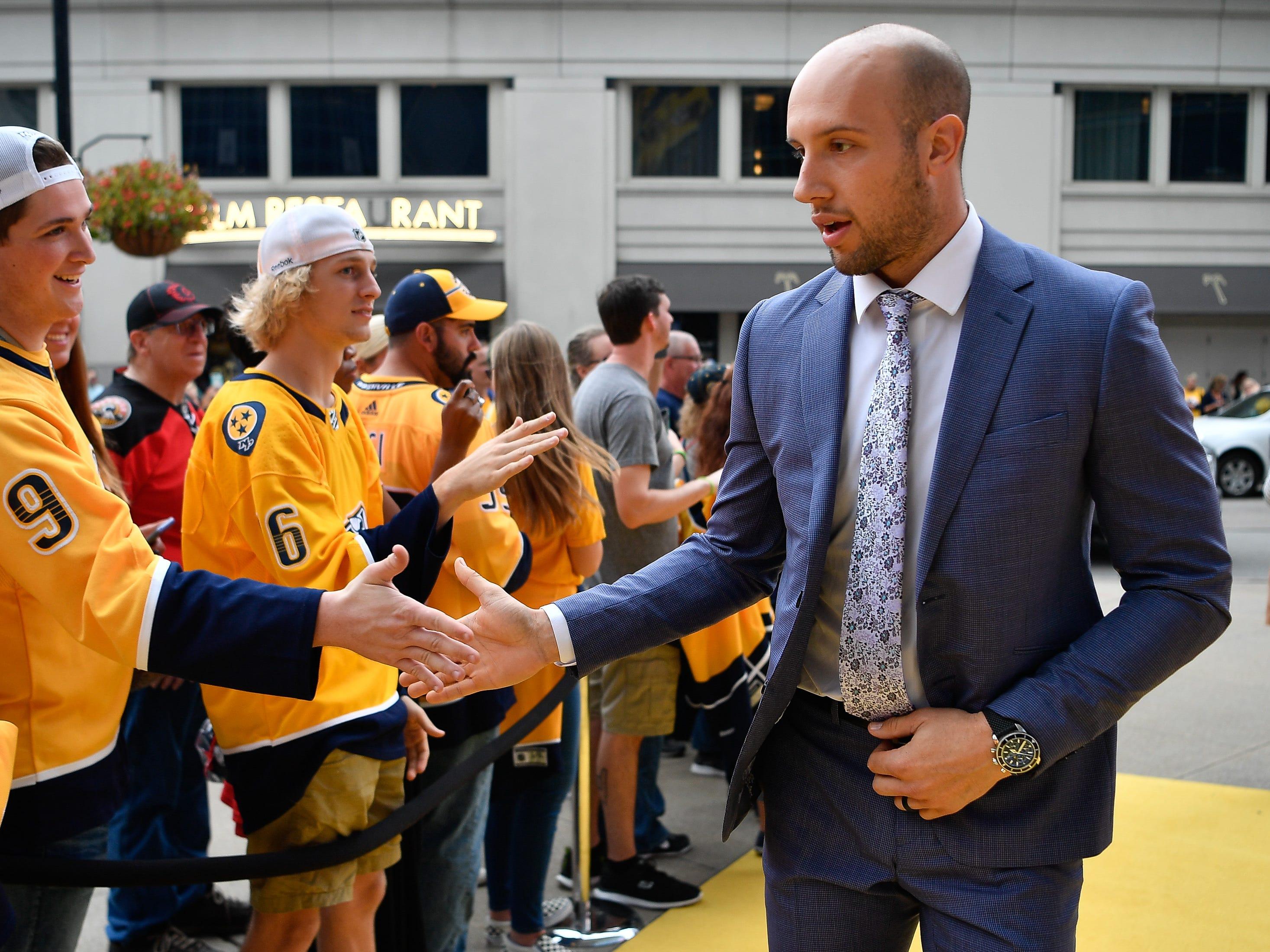 Nashville Predators center Nick Bonino greets fans during the Gold Walk before the home opener at Bridgestone Arena in Nashville, Tenn., Tuesday, Oct. 9, 2018.